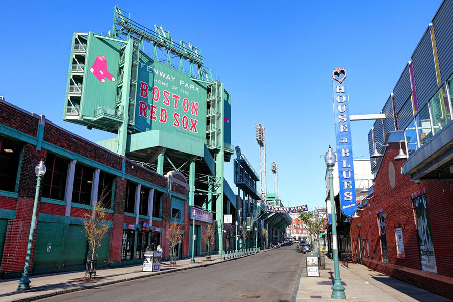 """The outside of Fenway Park reads """"Boston Red Sox"""""""