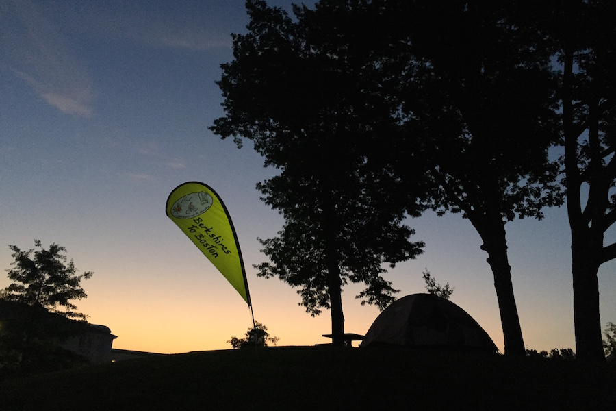 Silhouette of tree and camping tent against sky, Berkshires to Boston sign