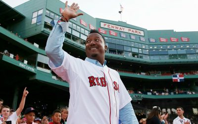 Pedro Martinez smiles and waves in a Red Sox jersey