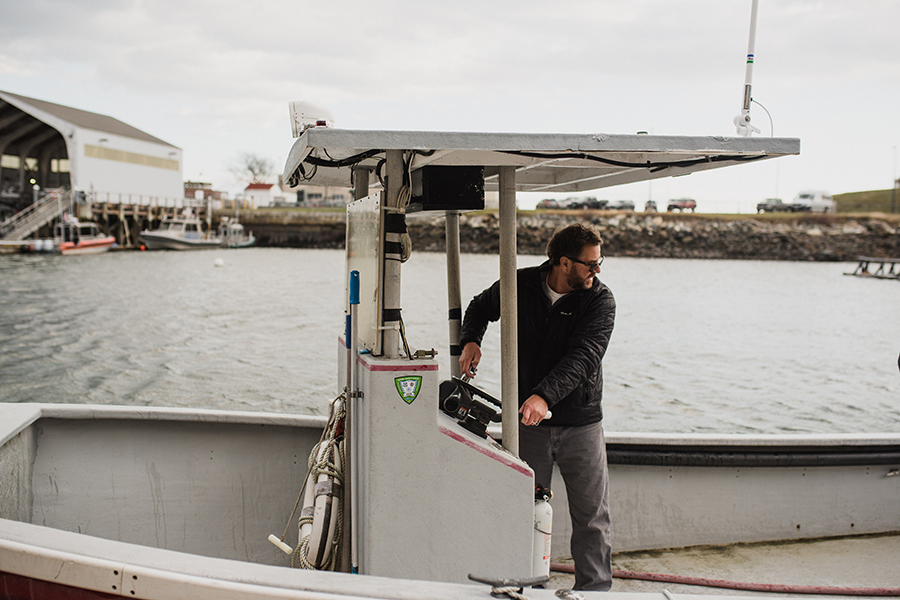 UNH and N.H. Sea Grant aquaculture specialist Michael Chambers drives the Red Cloud to the aquaculture platform