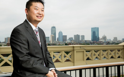 Tommy Chang in front of the skyline