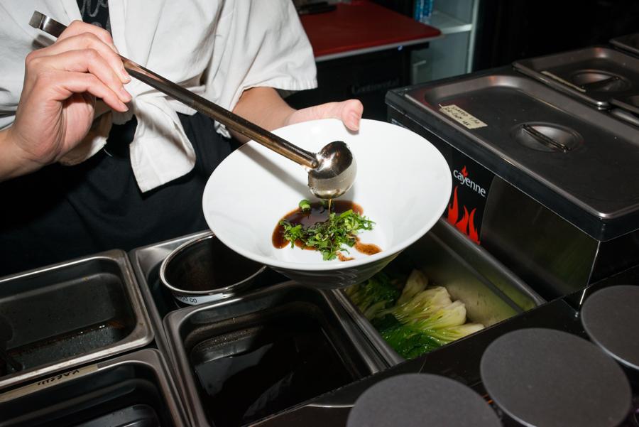 ChefMoe Kuroki makes a bowl of smoky shoyu ramen at Oisa Ramen Slurp & Go