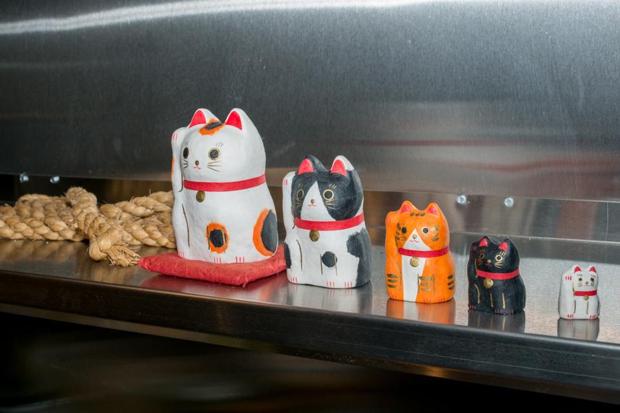 Lucky cats in the kitchen at Oisa Ramen Slurp & Go