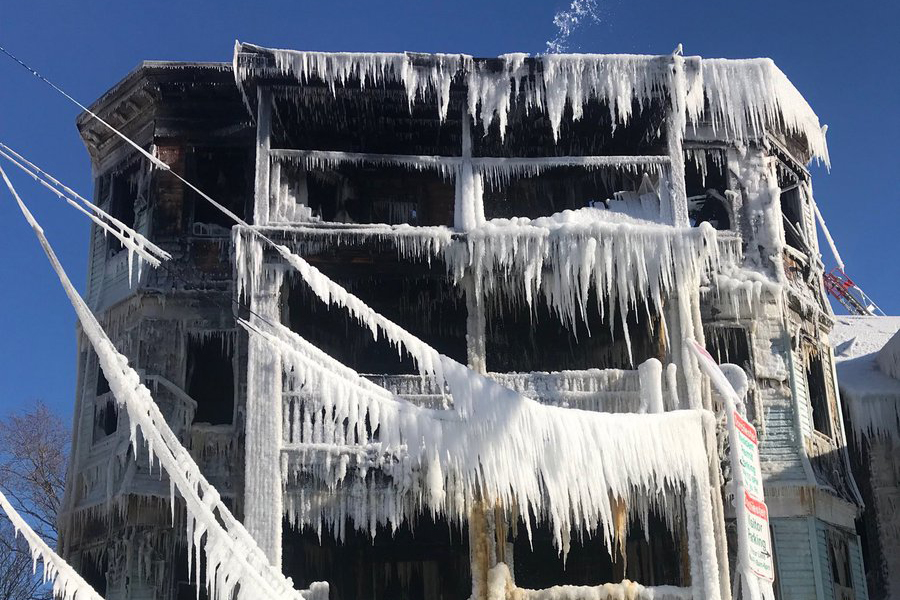 A three-story building covered in ice